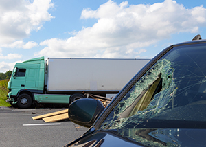 Semi-truck Accident from Road Debris Caused Five Vehicle Collision